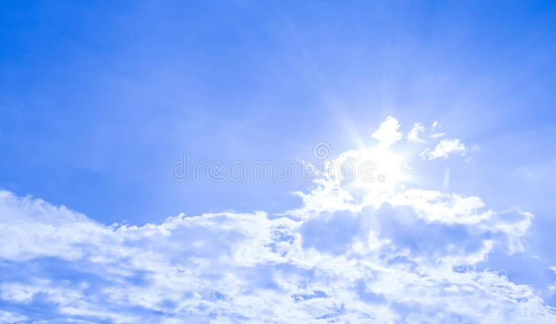 Natural sky background and radiating rays in a blue sky with clouds. That suitable for background, backdrop, wallpaper, display an royalty free stock photos