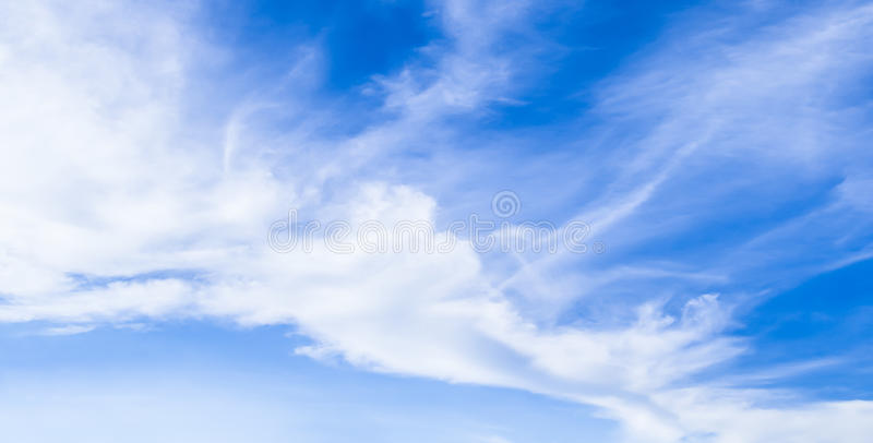Natural sky background and radiating rays in a blue sky with clouds. That suitable for background, backdrop, wallpaper, display an stock photos