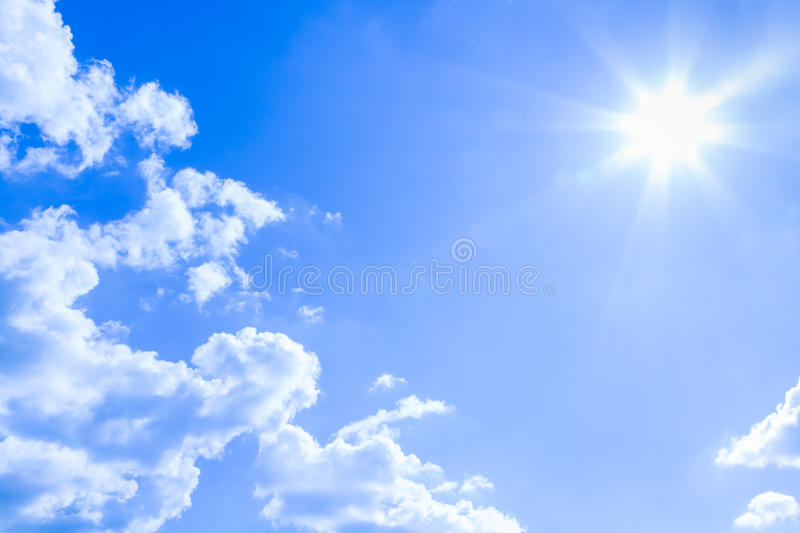 Natural sky background and radiating rays in a blue sky with clouds. That suitable for background, backdrop, wallpaper, display an stock images