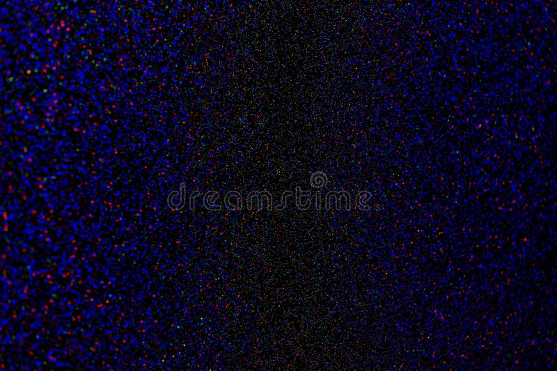 Natural small rgb lens blur on dark background. Natural small rgb lens boke blur on dark background with selective focus stock images