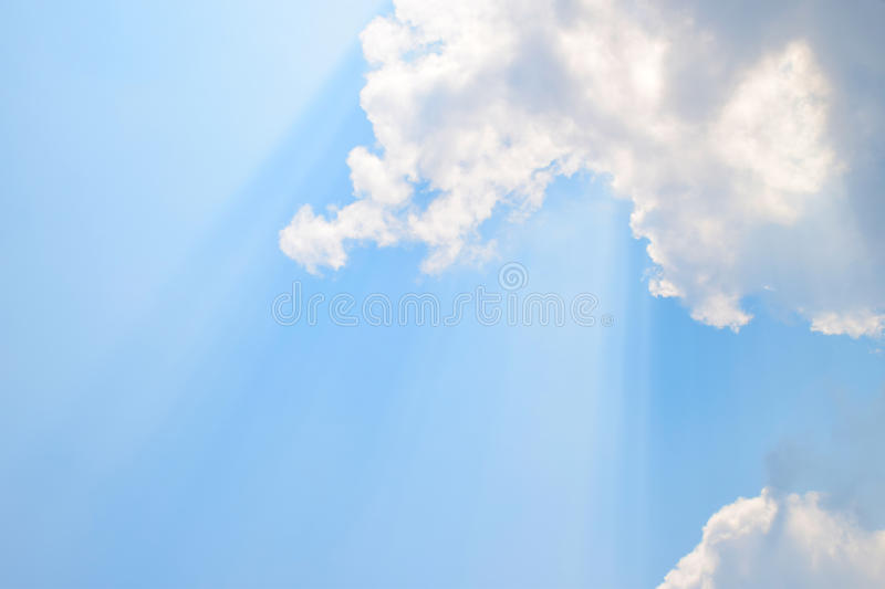 Natural soft clouds pattern and sunshine ray on blue sky background stock photos
