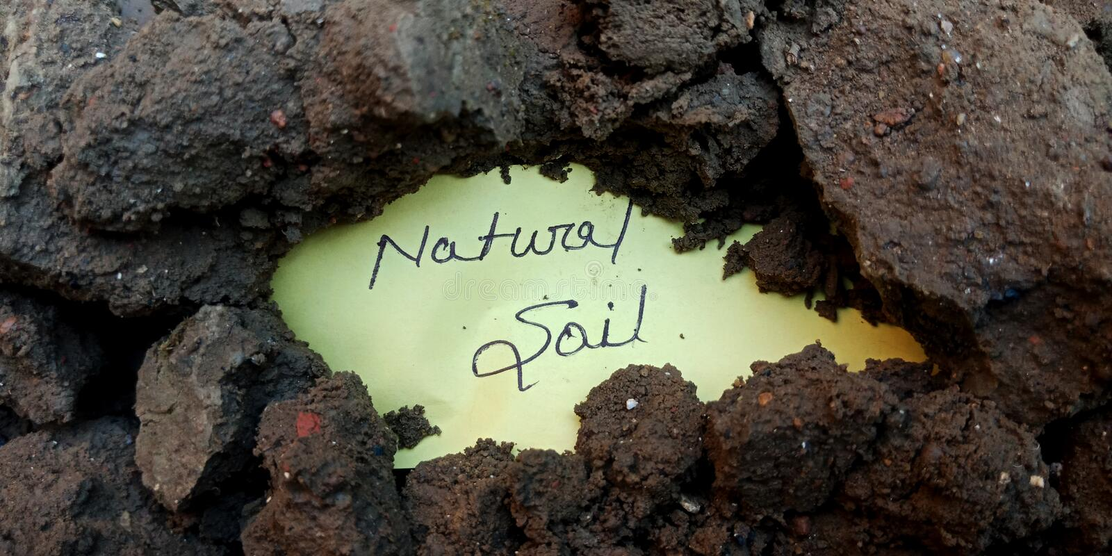 Natural soil text hand written text on horizontal land concept royalty free stock images