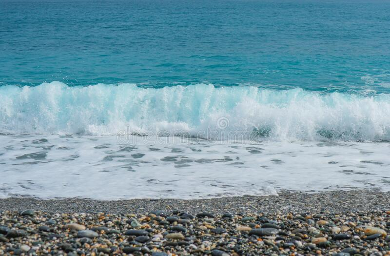 Natural splashing wave sea stone beach on sunny day at HUALIEN TAIWAN. Natural splashing wave sea stone beach on sunny day at HUALIEN TAIWAN stock photography