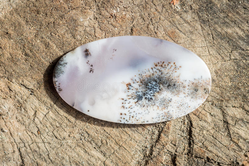 Natural stone agate on the wooden background royalty free stock photography