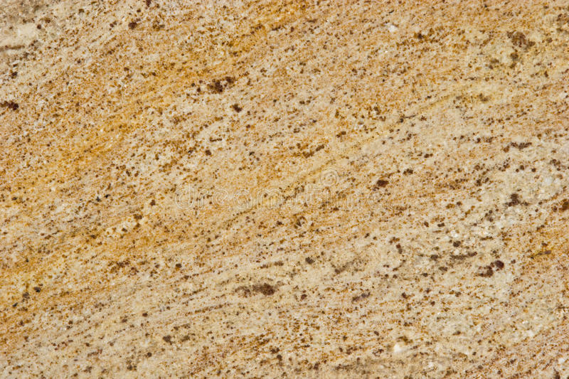 Natural Stone Backgrounds and Textures. Stone Backgrounds and Textures - Granite Slab Color - Millenium Gold stock photo