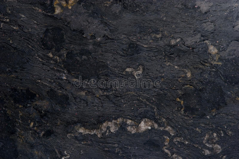 Natural Stone Backgrounds and Textures. Stone Backgrounds and Textures - Granite Slab Color - Titanium royalty free stock image