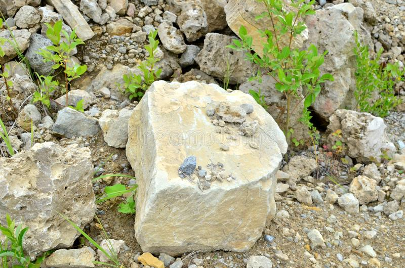 Natural stone dolomite in the limestone open-pit. Building materials, wall background, texture stock image