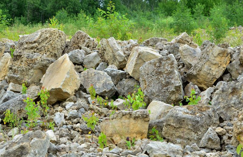 Natural stone dolomite in the limestone open-pit. Building materials, wall background, texture royalty free stock image