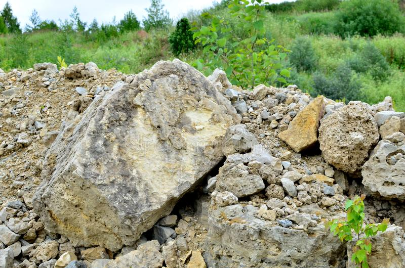 Natural stone dolomite in the limestone open-pit. Building materials, wall background, texture stock photo