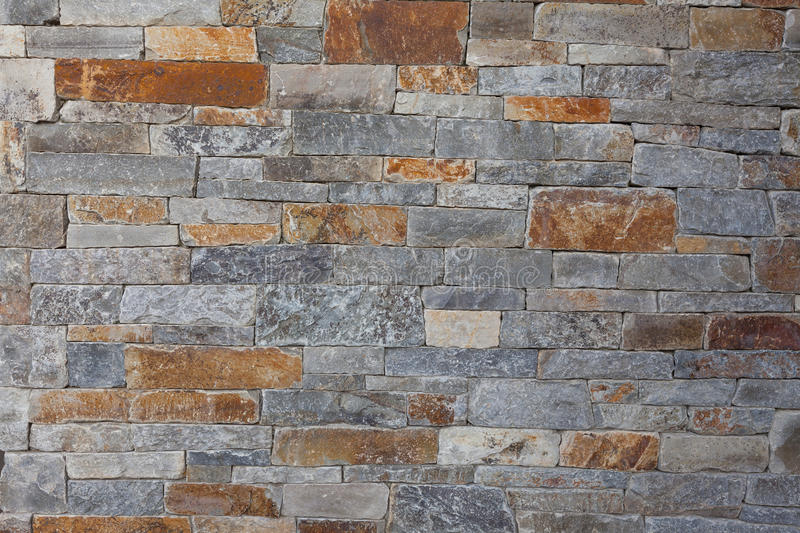 Natural stone granite brick wall pattern background, contemporary, luxury. Upscale natural stone wall pattern or background; horizontal format. The wall was royalty free stock photo