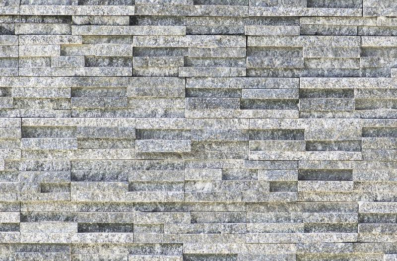 Natural stone granite pieces tiles for walls.  stock images
