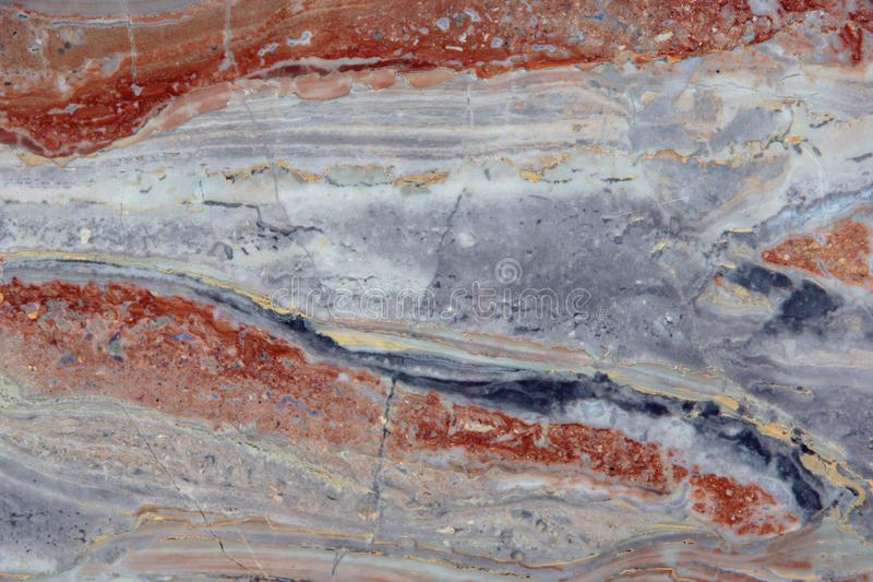 Natural stone Italian marble with gray, white and red stains, called Arabescato Gold stock photography