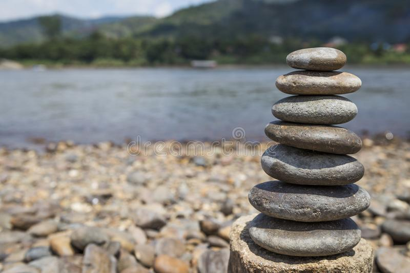 Natural stone stack over blurred river view background royalty free stock images