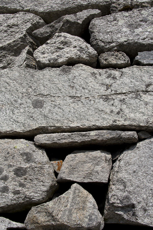 Natural stone wall. Beautiful background of an old natural mountain stone wall royalty free stock photo