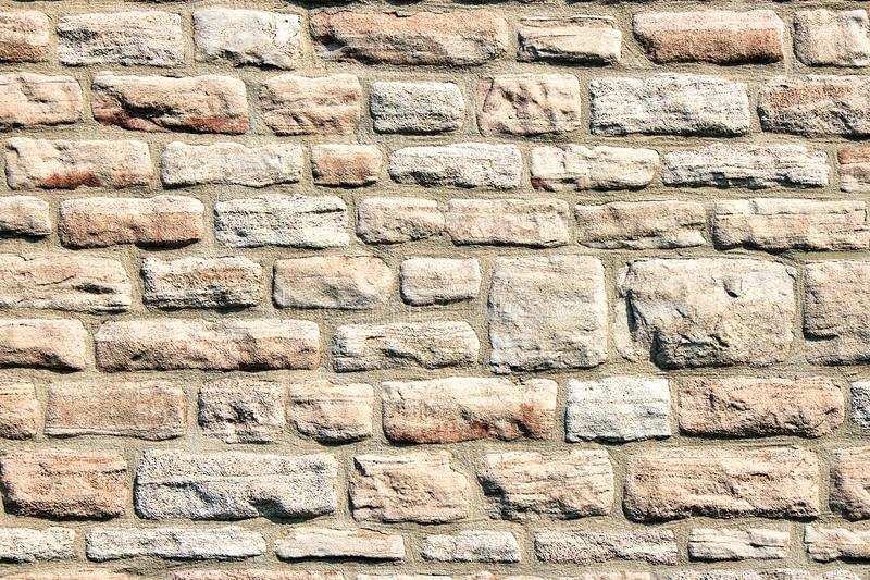 Natural stone wall. Background from a natural stone wall stock photos