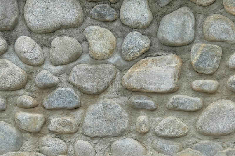Natural stone wall background royalty free stock image