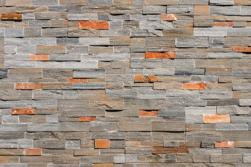 Natural stone wall cladding background royalty free stock images