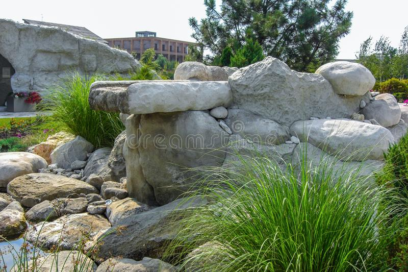 Natural stone waterfall cascade in pond design. stock photo