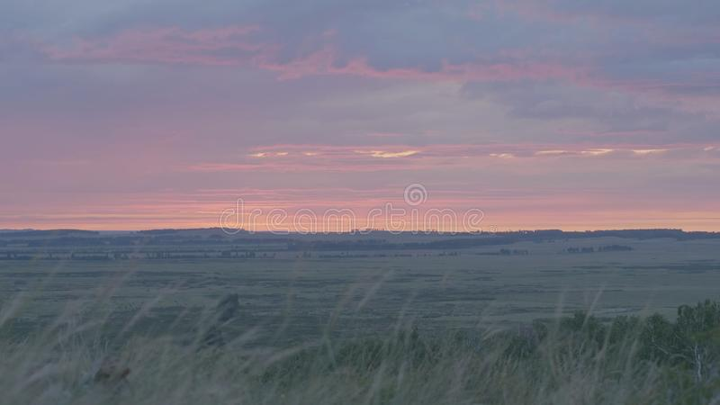 Natural Sunrise Over Field Or Meadow. Bright Dramatic Sky And Dark Ground. Countryside Landscape Under Scenic Colorful royalty free stock image