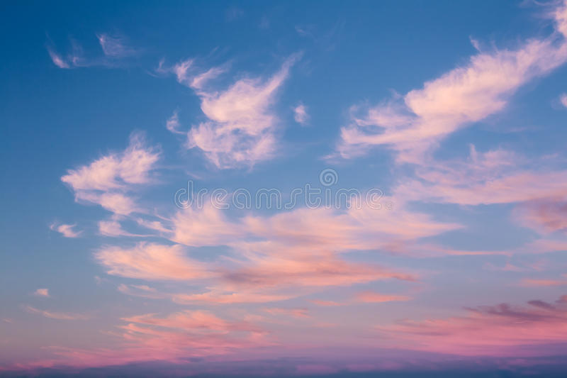 Natural Sunset Or Sunrise Sky With Blue, Pink And White Colors. Natural Dramatic Sunset Or Sunrise Sky With Blue, Pink And White Colors. Light Cloudy Evening Or royalty free stock photo