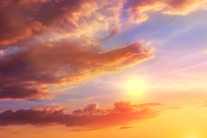 Natural sunset or sunrise with vibrant colors. Dramatic colorful sky background. Crocodile silhouette eating sun on twilight dusk royalty free stock photography