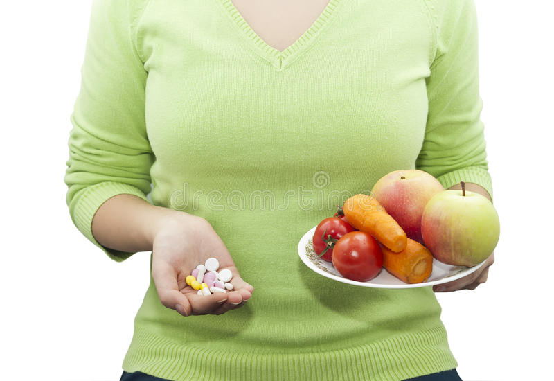 Natural and synthetic vitamins royalty free stock photography