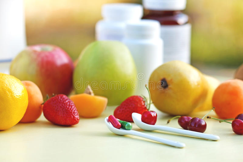 Natural or synthetic vitamins ? stock photography
