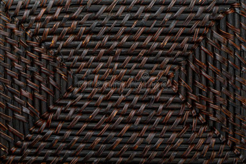 Natural texture of braided wicker of dark color. royalty free stock images