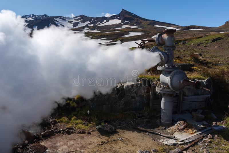 Natural thermal mineral steam-water emission from geological well stock photography