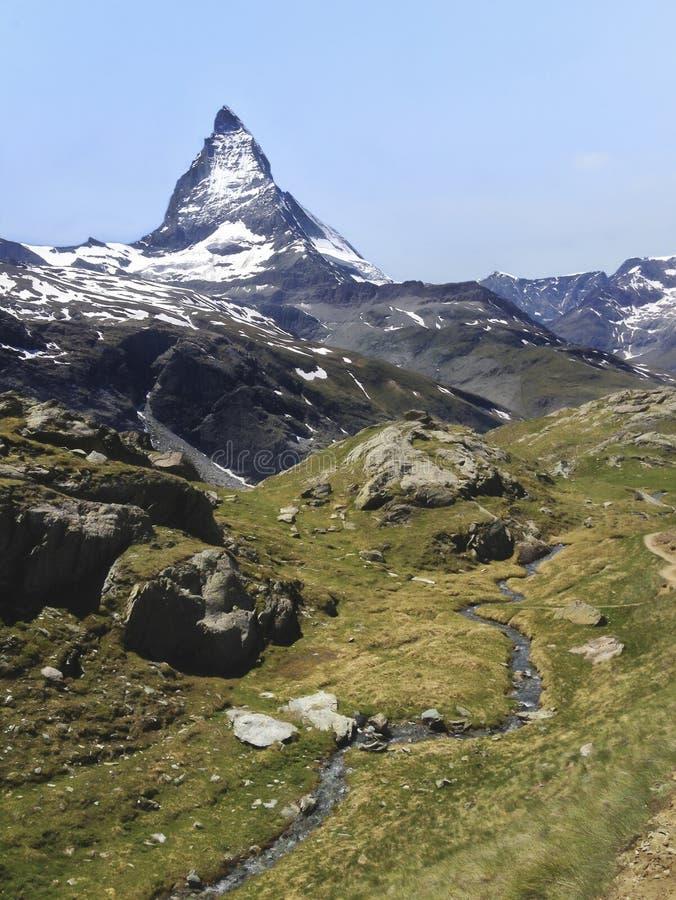 Natural Trail with view of Matterhorn Peak in summer, Zermatt, Switzerland, Europe. Family Activities, Hiking in the wild concept.  royalty free stock photo