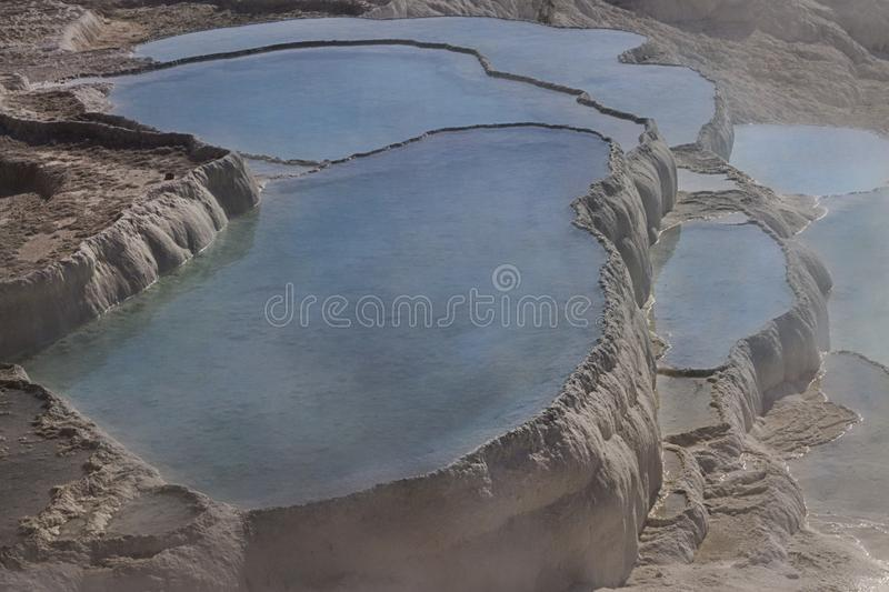 Natural travertine pools and terraces, Pamukkale, Turkey royalty free stock photos
