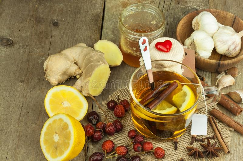 Natural treatment for colds and flu. Ginger lemon honey garlic and rosehip tea against influenza. Hot tea for colds. Home Pharmacy. Proven treatment of royalty free stock photo