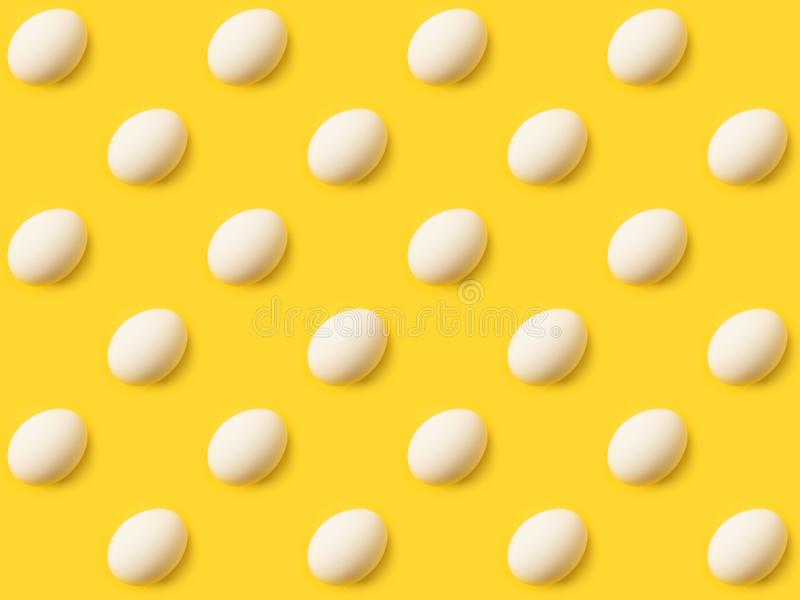 Collection of natural uncooked chicken eggs. Isolated on yellow royalty free illustration