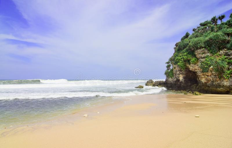 Natural views of the south coast in the Yogyakarta region. This beach is named `Drini beach`. This beach is white sand, next to it are cliffs and many rocks stock images