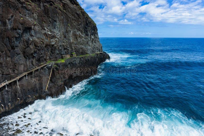 Natural volcanic lagoon pools at Porto Moniz, Madeira island. Portugal, nature, atlantic, blue, cliff, coast, coastline, landscape, ocean, outdoor, rock stock photography