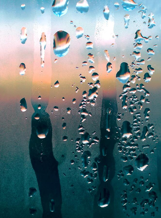 Natural water drops and sunlight on glass, abstract color royalty free stock photo