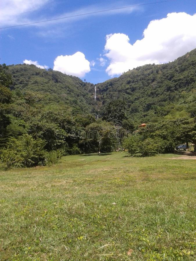 Natural waterfall Colombia. Spectacular view of the natural waterfall in Santander, Colombia, is located between the mountains. Nature, green, blue sky, outdoors stock photo