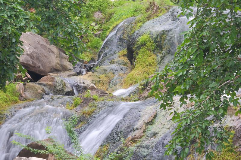 Natural waterfall in the rainy season. Rain water passing through rock cliffs has turned into beautiful waterfalls. this waterfalls is completely natural. water stock photography