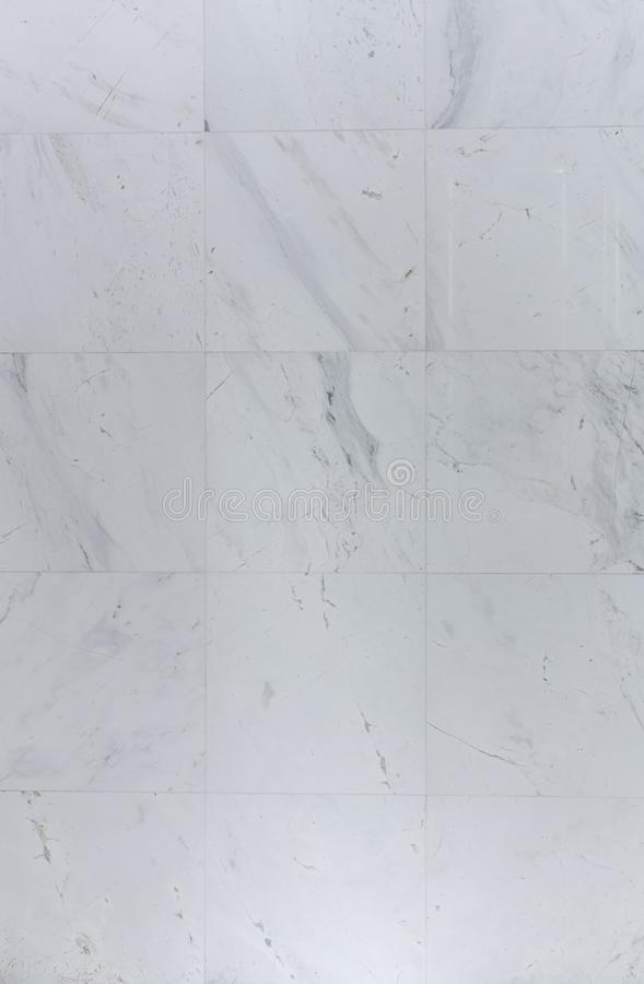 Natural white marble wall tiles install in bathroom / background texture / raw material royalty free stock photos