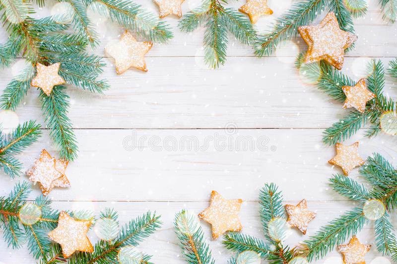 Natural white wooden background with spruce brunches and cookies stock images