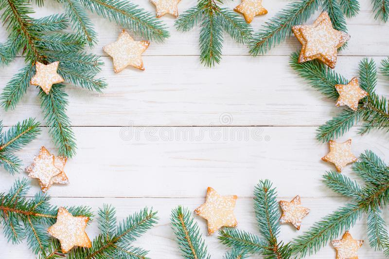 Natural white wooden background with spruce brunches and cookies royalty free stock photos