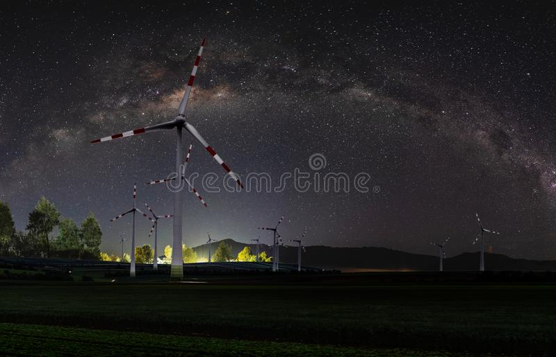 Natural wind power plant and sustainable eco-friendly energy resources at night with sky full of stars and milky way. Natural wind power plant and sustainable stock photos