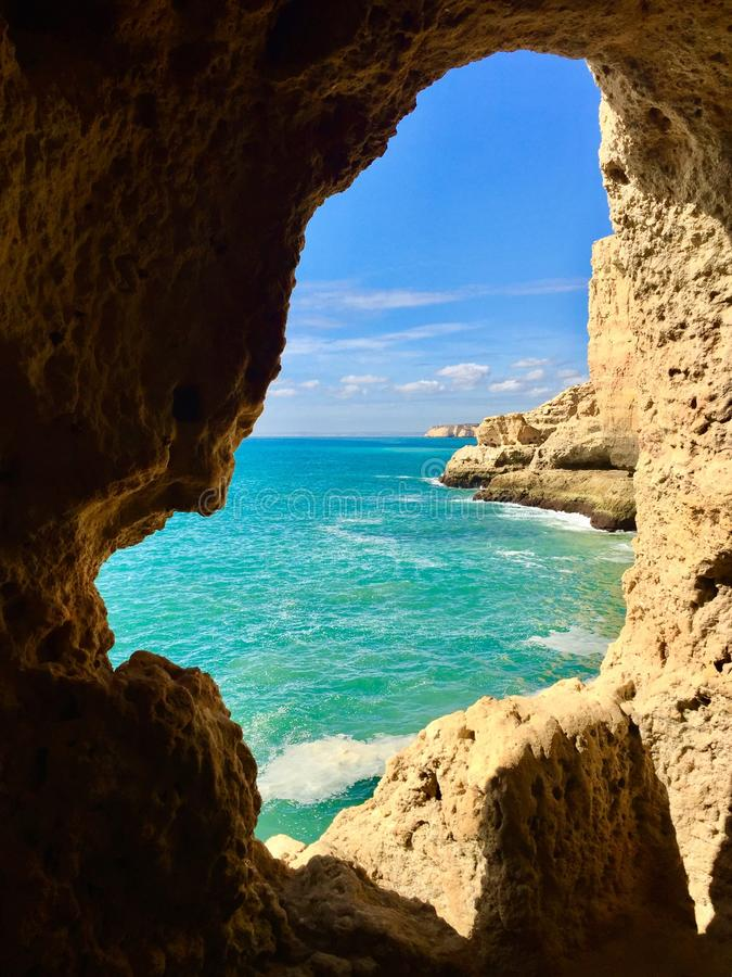 Natural window, Portugal. Natural window along the shores of Algarve, Portugal royalty free stock photography