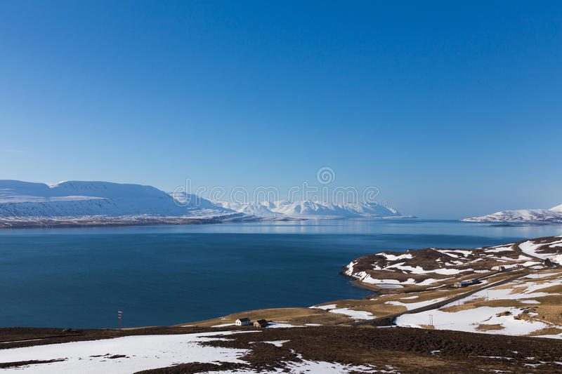 Natural winter season landscape with clear blue sky. Background, Iceland royalty free stock photography