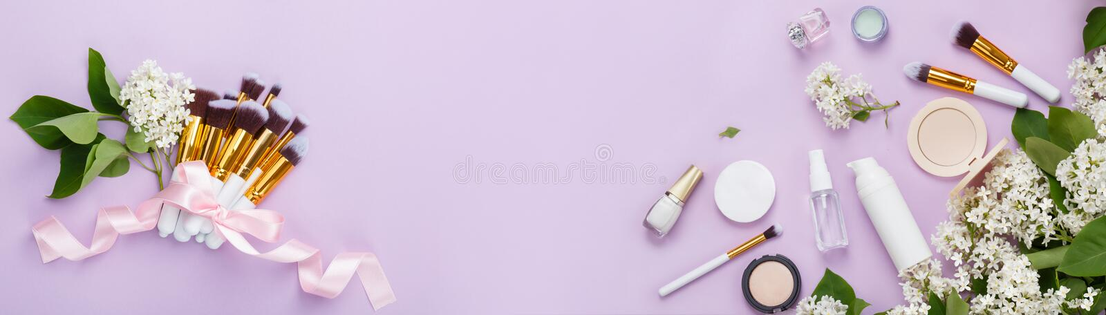 Natural woman make up cosmetics with spring white lilac bloom, banner royalty free stock photos