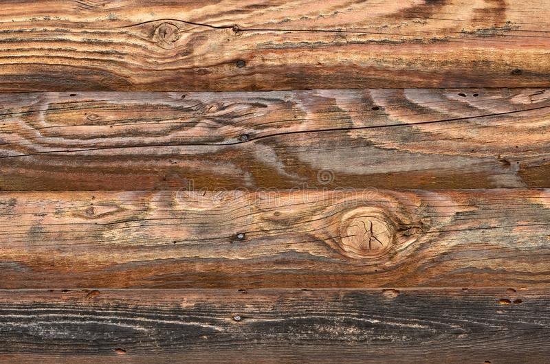 Wood beams with natural color, grain and knots. Wood texture. Seamless wall made of wooden beams with visible grain and knots texture. Rustic background for royalty free stock image
