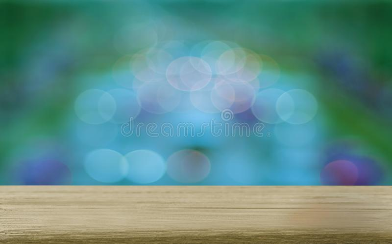 Natural wood table surface with a beautiful bokeh of the city lights blur background, with empty space and copy space, and for royalty free stock images