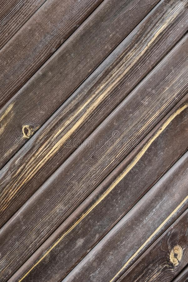 Natural wood texture. Brown old weathered planks for background. Diagonal arrangement royalty free stock images