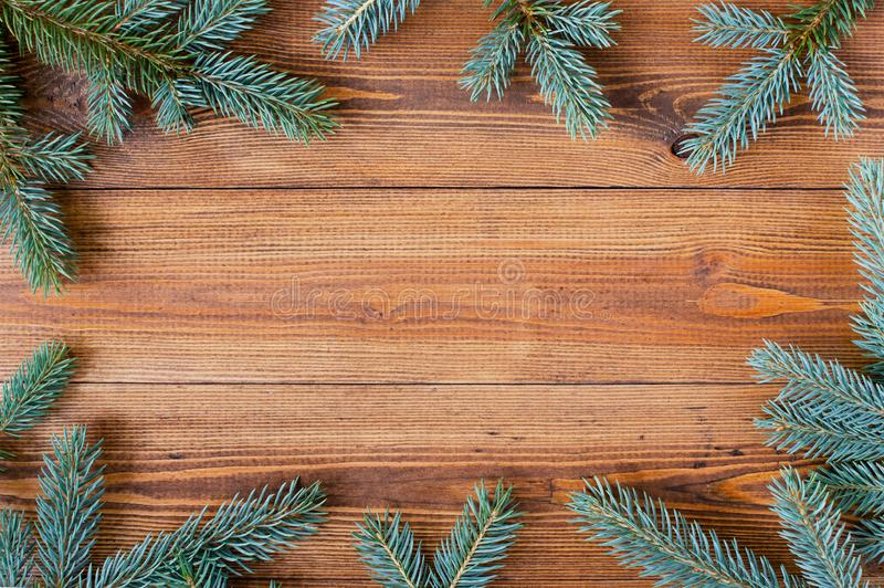 Natural wooden background with spruce brunches stock photo