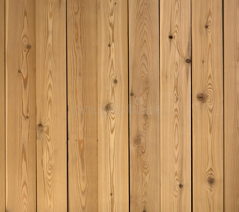 Vertical Parallel Wooden Boards On A Wall On A Dark